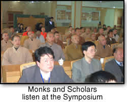 Monks and Scholars listen at the Symposium