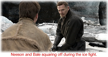 Neeson and Bale squaring off during the ice fight