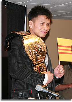 Cung Li and his Strikeforce Middleweight Champion belt