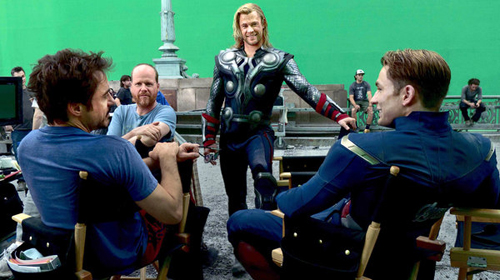 Director Joss Whendon on the set with Robert Downey Jr., Chris Hemsworth and Chris Evans