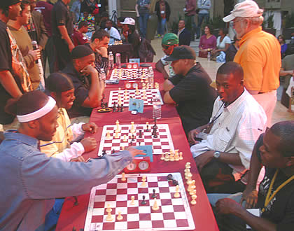 The Celebrity Chess Kings Tournament portion of the event: the eight playas are RZA, GZA, Paris, Amir Sulaiman, Ralek Gracie, Sunspot Jonz, Casual, and Monk