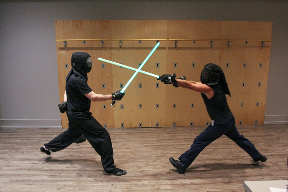 Chad Eisner (left) sparring with one of his students.