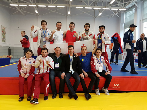 Georgia Wushu Fed President Giorgi Verulidze is front center